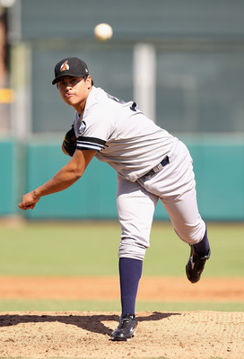 SCOTTSDALE, AZ - OCTOBER 23:  New York Yankees prospect Manuel Banuelos playing for the Phoenix Desert Dogs pitches against the Scottsdale Scorpions during the AZ Fall League game at Scottsdale Stadium on October 23, 2010 in Scottsdale, Arizona.  (Photo b