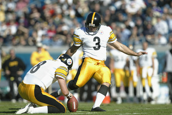 JACKSONVILLE, FL - DECEMBER 1:  Jeff Reed #3 of the Pittsburgh Steelers kicks the ball from the hold of Tommy Maddox #8 against the Jacksonville Jaguars during the NFL game on December 1, 2002 at Alltel Stadium in Jacksonville, Florida.  The Steelers won