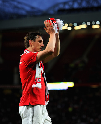 MANCHESTER, ENGLAND - MAY 24: Gary Neville salutes the crowd after the Gary Neville Testimonial Match between Manchester United and Juventus at Old Trafford on May 24, 2011 in Manchester, England.  (Photo by Michael Regan/Getty Images)