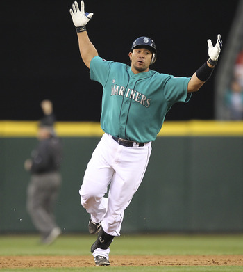 SEATTLE - JUNE 17:  Miguel Olivo #30 of the Seattle Mariners reacts after center fielder Shane Victorino #8 of the Philadelphia Phillies made a leaping catch of his deep drive at the wall at Safeco Field on June 17, 2011 in Seattle, Washington. (Photo by