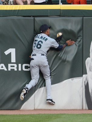 CHICAGO, IL - JUNE 06: Greg Halman #56 of the Seattle Mariners catches a ball hit by Carlos Quentin of the Chicago White Sox as he hits the outfield wall at U.S. Cellular Field on June 6, 2011 in Chicago, Illinois. (Photo by Jonathan Daniel/Getty Images)