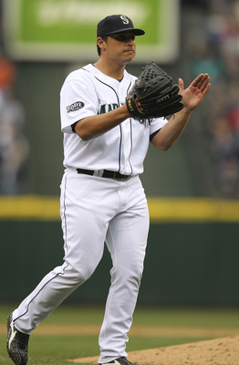 SEATTLE - JUNE 19:  Starting pitcher Jason Vargas #38 of the Seattle Mariners celebrates after throwing a complete game 2-0 shutout  against the Philadelphia Phillies at Safeco Field on June 19, 2011 in Seattle, Washington. (Photo by Otto Greule Jr/Getty