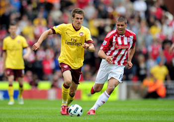 STOKE ON TRENT, ENGLAND - MAY 08:  Aaron Ramsey of Arsenal is pursued by Jonathan Walters (R) of Stoke during the Barclays Premier League match between Stoke City and Arsenal at the Britannia Stadium on May 8, 2011 in Stoke on Trent, England.  (Photo by S