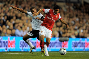 LONDON, ENGLAND - SEPTEMBER 21:  Carlos Vela of Arsenal holds off the challenge from Kyle Naughton of Spurs during the Carling Cup third round match between Tottenham Hotspur and Arsenal at White Hart Lane on September 21, 2010 in London, England.  (Photo