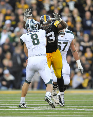 IOWA CITY, IA - OCTOBER 30- Quarterback Kirk Cousins #8 of the Michigan State Spartans throws under pressure from defensive lineman Mike Daniels #93 of the University of Iowa Hawkeyes during the second half of play at Kinnick Stadium on October 30, 2010 i