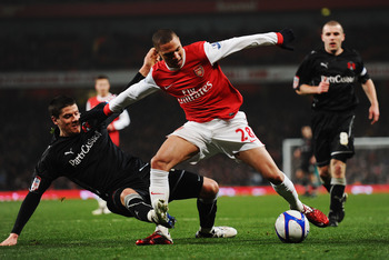 LONDON, UNITED KINGDOM - MARCH 02:  Alex Revell (L) of Leyton Orient tackles Kieran Gibbs (R) of Arsenal and concedes a penalty during the FA Cup sponsored by E.ON 5th Round Replay match between between Arsenal and Leyton Orient at the Emirates Stadium on
