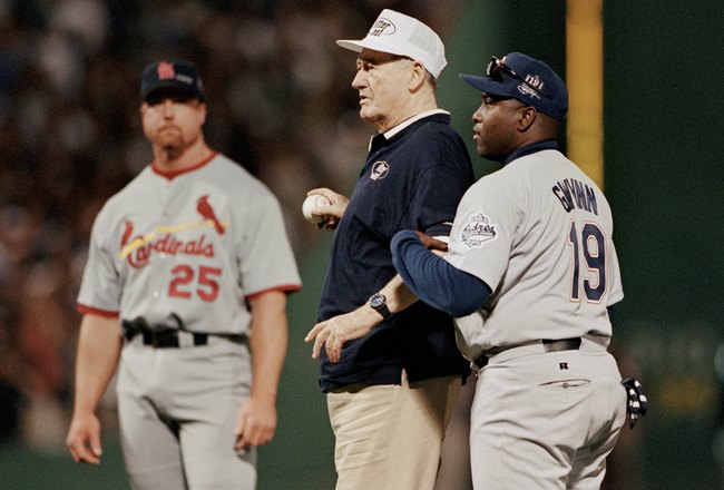 BOSTON - JULY 13:  Hall of Famer Ted Williams throws out the first pitch as Tony Gwynn #19 of the National League stands with him during the 1999 MLB All-Star Game at Fenway Park on July 13, 1999 in Boston, Massachusetts. (Photo by Brian Bahr/Getty Images