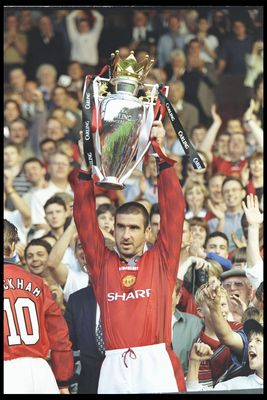 Aug 1996:  Eric Cantona of Manchester United holds aloft the Premier League trophy before the start of  the pre-season friendly between Manchester United and Inter Milan at Old Trafford , Manchester. Mandatory Credit: Mike Hewitt/ Allsport UK