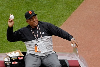 SAN FRANCISCO - JULY 10:  Baseball Hall-of-Famer Willie Mays #24 of the San Francisco Giants throws out baseballs after being honored prior to the 78th Major League Baseball All-Star Game at AT&T Park on July 10, 2007 in San Francisco, California.  (Photo