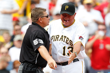 PITTSBURGH - JUNE 26:  Manager Clint Hurdle #13 of the Pittsburgh Pirates argues with home plate umpire Greg Gibson about a play at the plate involving David Ortiz #34 of the Boston Red Sox during the game on June 26, 2011 at PNC Park in Pittsburgh, Penns