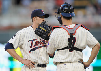 MINNEAPOLIS, MN - JULY 5: Scott Baker #30 and Joe Mauer #7 of the Minnesota Twins speak on the mound during the fourth inning of the game against the Tampa Bay Rays on July 5, 2011 at Target Field in Minneapolis, Minnesota. (Photo by Hannah Foslien/Getty