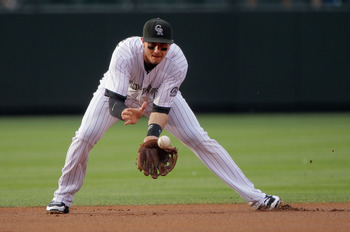 DENVER, CO - JUNE 29:  Shortstop Troy Tulowitzki #2 of the Colorado Rockies fields a ground ball against the Chicago White Sox during Interleague play at Coors Field on June 29, 2011 in Denver, Colorado. The White Sox defeated the Rockies 3-2.  (Photo by