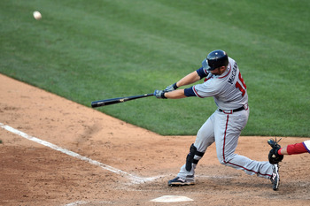 PHILADELPHIA, PA - JULY 09: Brian McCann #16 of the Atlanta Braves hits a two-run home run in the top of the 11th inning during the game against the Philadelphia Phillies at Citizens Bank Park on July 9, 2011 in Philadelphia, Pennsylvania. The Braves won