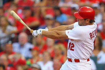 ST. LOUIS, MO - JULY 9: Lance Berkman #12 of the St. Louis Cardinals looses his bat against the Arizona Diamondbacks at Busch Stadium on July 9, 2011 in St. Louis, Missouri.  (Photo by Dilip Vishwanat/Getty Images)
