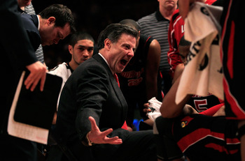 NEW YORK, NY - MARCH 11: Head coach Rick Pitino of the Louisville Cardinals reacts during a timeout against the Notre Dame Fighting Irish during the semifinals of the 2011 Big East Men's Basketball Tournament presented by American Eagle Outfitters at Madi