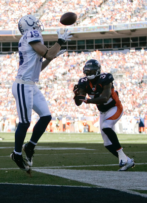 DENVER - SEPTEMBER 26:  Wide receiver Blair White #15 of the Indianapolis Colts makes a catch for a touchdown against cornerback Perrish Cox #32 of the Denver Broncos during NFL action at INVESCO Field at Mile High on September 26, 2010 in Denver, Colorad