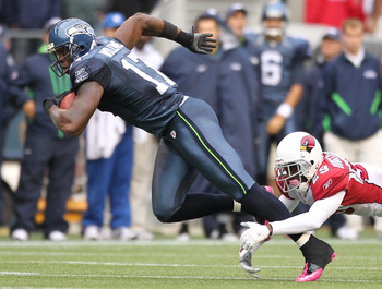SEATTLE - OCTOBER 24:  Wide receiver Mike Williams #17 of the Seattle Seahawks rushes against Dominique Rodgers-Cromartie #29 of the Arizona Cardinals at Qwest Field on October 24, 2010 in Seattle, Washington. (Photo by Otto Greule Jr/Getty Images)
