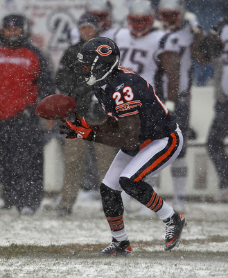 CHICAGO, IL - DECEMBER 12: Devin Hester #23 of the Chicago Bears fields a punt against the New England Patriots at Soldier Field on December 12, 2010 in Chicago, Illinois. The Patriots defeated the Bears 36-7. (Photo by Jonathan Daniel/Getty Images