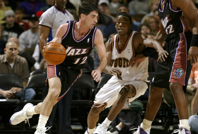 DENVER - JANUARY 15: Guard John Stockton #12 of the Utah Jazz drives around Junior Harrington #6 of the Denver Nuggets in the first quarter on January 15, 2003 at the Pepsi Center in Denver, Colorado.   NOTE TO USER:  User expressly acknowledges and agree