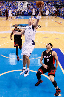 DALLAS, TX - JUNE 09:  Jason Kidd #2 of the Dallas Mavericks drives for a shot attempt against Mike Bibby #0 of the Miami Heat in Game Five of the 2011 NBA Finals at American Airlines Center on June 9, 2011 in Dallas, Texas.  NOTE TO USER: User expressly