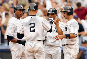 NEW YORK - JUNE 18: Derek Jeter #2 of the New York Yankees is congratulated by (L-R) Bernie Williams #51, Robinson Cano #22 and Jorge Posada #20 after he hit his first grand slam home run at the bottom of the sixth against Joe Borowski #48 of the Chicago