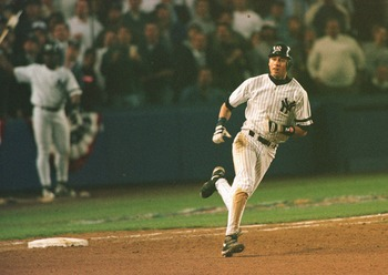 9 Oct 1996:  Batter Derek Jeter of the New York Yankees rounds first base after his controversial homerun in game one of the American League Championship Series during the Yankees 5-4 win over the Boston Orioles at Yankee Stadium in the Bronx, New York, N