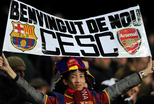 BARCELONA, SPAIN - MARCH 08:  A fan holds up a banner welcoming Cesc Fabregas of Arsenal to the Camp Nou stadium prior to the start of the UEFA Champions League round of 16 second leg match between Barcelona and Arsenal on March 8, 2011 in Barcelona, Spai