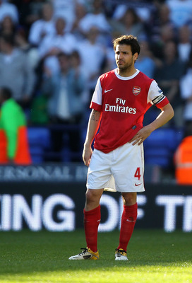 BOLTON, ENGLAND - APRIL 24:  Cesc Fabregas of Arsenal looks dejected at the end of the Barclays Premier League match between Bolton Wanderers and Arsenal at the Reebok Stadium on April 24, 2011 in Bolton, England.  (Photo by Clive Brunskill/Getty Images)