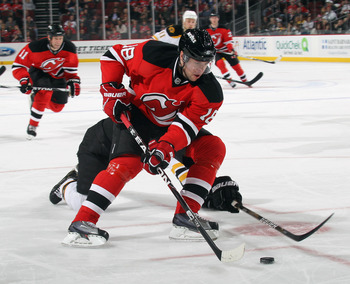 NEWARK, NJ - APRIL 10: Vladimir Zharkov #18 of the New Jersey Devils skates against the Boston Bruins at the Prudential Center on April 10, 2011 in Newark, New Jersey.  (Photo by Bruce Bennett/Getty Images)