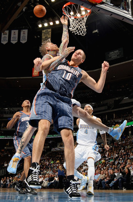 DENVER, CO - MARCH 02:  Chris Andersen #11 of the Denver Nuggets is fouled by Joel Pryzbilla #10 of the Charlotte Bobcats at the Pepsi Center on March 2, 2011 in Denver, Colorado. NOTE TO USER: User expressly acknowledges and agrees that, by downloading a