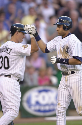 10 Jul 2001:  Derek Jeter (r) of the New York Yankees celebrates his home run with teammate Magglio Ordonez of the Chicago White Sox during the 2001 Major League Baseball All-Star Game at Safeco Field in  Seattle, Washington. DIGITAL IMAGE. Mandatory Cred