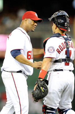 WASHINGTON, DC - JUNE 15:  Livan Hernandez #61 of the Washington Nationals celebrates with Ivan Rodriguez #7 after pitching a complete game 10-0 shutout against the St. Louis Cardinals at Nationals Park on June 15, 2011 in Washington, DC.  (Photo by Greg