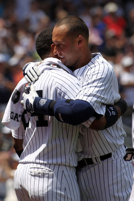 NEW YORK, NY - JULY 09:  Derek Jeter #2 of the New York Yankees celebrates at home with teammate Robinson Cano #24 after hitting a solo home run in the third inning for career hit 3000 while playing against the Tampa Bay Rays at Yankee Stadium on July 9,