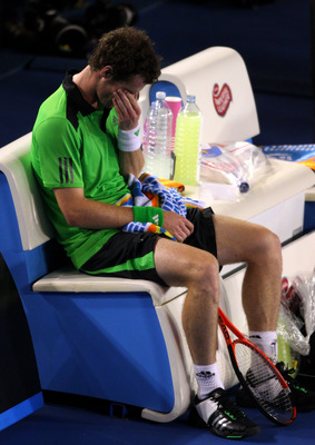 MELBOURNE, AUSTRALIA - JANUARY 30:  Andy Murray of Great Britain reacts after losing the men's final match against Novak Djokovic of Serbia during day fourteen of the 2011 Australian Open at Melbourne Park on January 30, 2011 in Melbourne, Australia.  (Ph