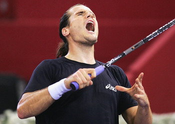MADRID, SPAIN - OCTOBER 21:  Tommy Hass of Germany  reacts during his third round match against Taylor Dent of USA during the ATP Madrid Masters at the Nuevo Rockodromo on October 21, 2004 in Madrid, Spain. (Photo by Jamie McDonald/Getty Images)