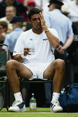 LONDON - JULY 6:  Mark Philippoussis of Australia feels the pressure against Roger Federer of Switzerland in the Men's Singles Final during the final day of the Wimbledon Lawn Tennis Championships held on July 6, 2003 at the All England Lawn Tennis and Cr