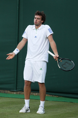 LONDON, ENGLAND - JUNE 21:  Ernests Gulbis of Latvia reacts during his first round match against Dmitry Tursunov of Russia  on Day Two of the Wimbledon Lawn Tennis Championships at the All England Lawn Tennis and Croquet Club on June 21, 2011 in London, E