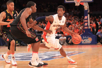 NEW YORK - NOVEMBER 19:  D.J Richardson #1 of the Illinois Fighting Illini tries to get around Dino Gregory #33 of the Maryland Terrapins during the 2k Sports Classic at Madison Square Garden on November 19, 2010 in New York, New York.  (Photo by Chris Mc