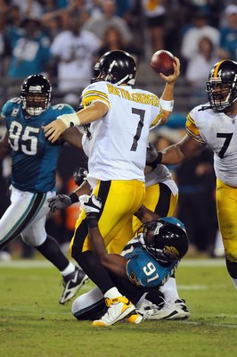 JACKSONVILLE, FL - OCTOBER 05:  Quarterback Ben Roethlisberger #7 of the Pittsburgh Steelers is sacked by Derrick Harvey #91 of the Jacksonville Jaguars at Jacksonville Municipal Stadium on October 5, 2008 in Jacksonville, Florida.  (Photo by Sam Greenwoo