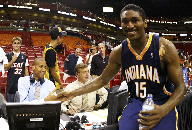 MIAMI - NOVEMBER 03:  Ron Artest #15 of the Indiana Pacers greets former teammate Reggie Miller after defeating the Miami Heat November 3, 2005 at the American Airlines Arena in Miami, Florida. The Pacers defeated the Heat 105-102. NOTE TO USER: User expr
