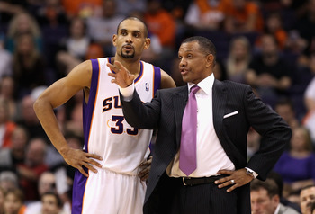 PHOENIX, AZ - JANUARY 14:  Head coach Alvin Gentry of the Phoenix Suns talks with Grant Hill #33 during the NBA game against the Portland Trail Blazers at US Airways Center on January 14, 2011 in Phoenix, Arizona. The Suns defeated the 115-111.  NOTE TO U