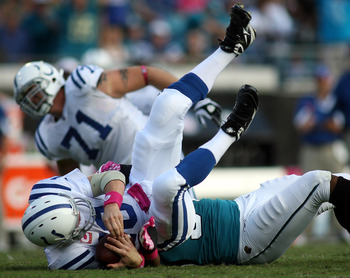 JACKSONVILLE, FL - OCTOBER 03:  Quarterback Peyton Manning #18 of the Indianapolis Colts is sacked by Lineman Jeremy Mincey #94 of the Jacksonville Jaguars at EverBank Field on October 3, 2010 in Jacksonville, Florida.  (Photo by Marc Serota/Getty Images)