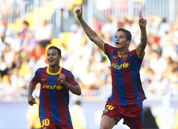 MALAGA, VALENCIA - MAY 21:  Ibrahim Afellay (R) of Barcelona celebrates after scoring during the La Liga match between Malaga and Barcelona at La Rosaleda Stadium on May 21, 2011 in Malaga, Spain.  (Photo by Manuel Queimadelos Alonso/Getty Images)