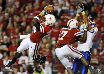 LINCOLN, NB - SEPTEMBER 25: Cornerback Alfonzo Dennard #15 of the Nebraska Cornuskers intercepts a ball from  wide receiver Aaron Rollin #5 of the South Dakota State Jackrabbits during second half action of their game at Memorial Stadium on September 25,
