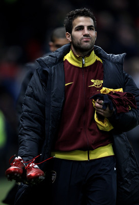 MANCHESTER, UNITED KINGDOM - DECEMBER 13:   Cesc Fabregas of Arsenal heads for the substitutes bench prior to the Barclays Premier League match between Manchester United and Arsenal at Old Trafford on December 13, 2010 in Manchester, England. (Photo by Al