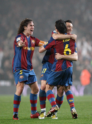 BARCELONA, SPAIN - FEBRUARY 27:  Xavi Hernandez (R) of Barcelona celebrates his last minute equalizer with his teammates Gianluca Zambrotta (C) and Carles Puyol during the Copa del Rey semi final match between Barcelona and Valencia at the Camp Nou Stadiu