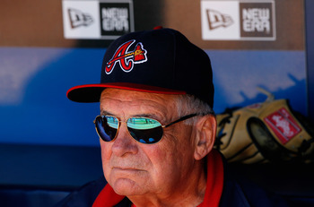 ATLANTA - OCTOBER 10:  Manager Bobby Cox #6 of the Atlanta Braves sits in the dugout during batting practice before facing the San Francisco Giants during Game Three of the NLDS of the 2010 MLB Playoffs at Turner Field on October 10, 2010 in Atlanta, Geor