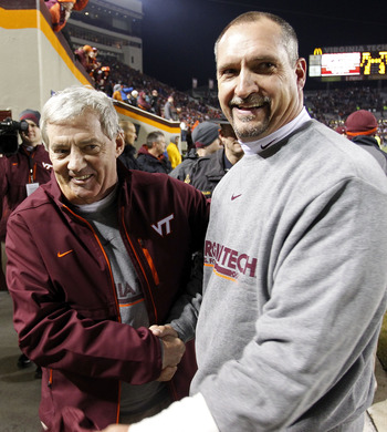 BLACKSBURG, VA - NOVEMBER 04: Head coach Frank Beamer (L) of the Virginia Tech Hokies celebrates with defensive coordinator Bud Foster (R) after the Hokies defeated the Georgia Tech Yellow Jackets 28-21 at Lane Stadium on November 4, 2010 in Blacksburg, V