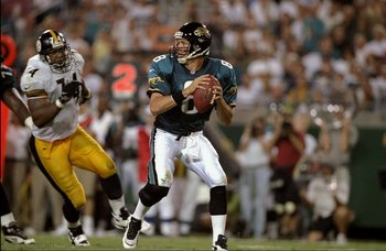 22 Sep 1997:  Quarterback Mark Brunell #8 of the Jacksonville Jaguars is pursued by Nolan Harrison #74 of the Pittsburgh Steelers during a game at the Alltell Stadium in Jacksonville, Florida. The Jaguars defeated the Steelers 30-21. Mandatory Credit: And