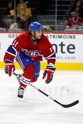 MONTREAL, CANADA - MARCH 8:  Scott Gomez #11 of the Montreal Canadiens skates during the NHL game against the Boston Bruins at the Bell Centre on March 8, 2011 in Montreal, Quebec, Canada.  The Canadiens defeated the Bruins 4-1.  (Photo by Richard Wolowic
